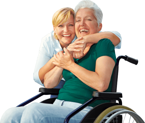 portrait of smiling caregiver and disabled senior women in wheelchair