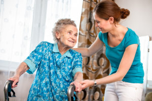 senior women with her caregiver at home