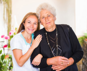 photo of happy elderly women with her caregiver