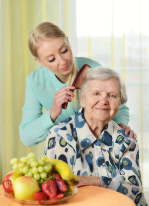 senior women with her caregiver